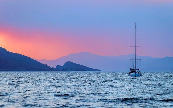 Sailboat over Sunset Sky