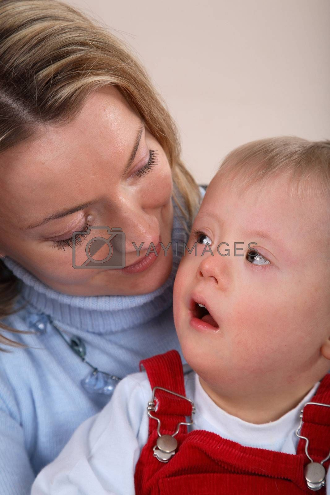 Down Syndrome boy with mother by linea