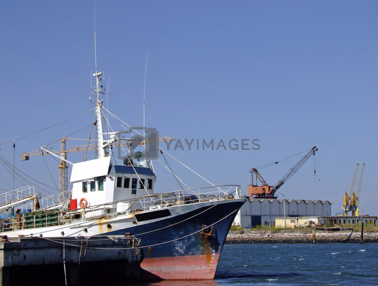 Fishing boat on dock by PauloResende