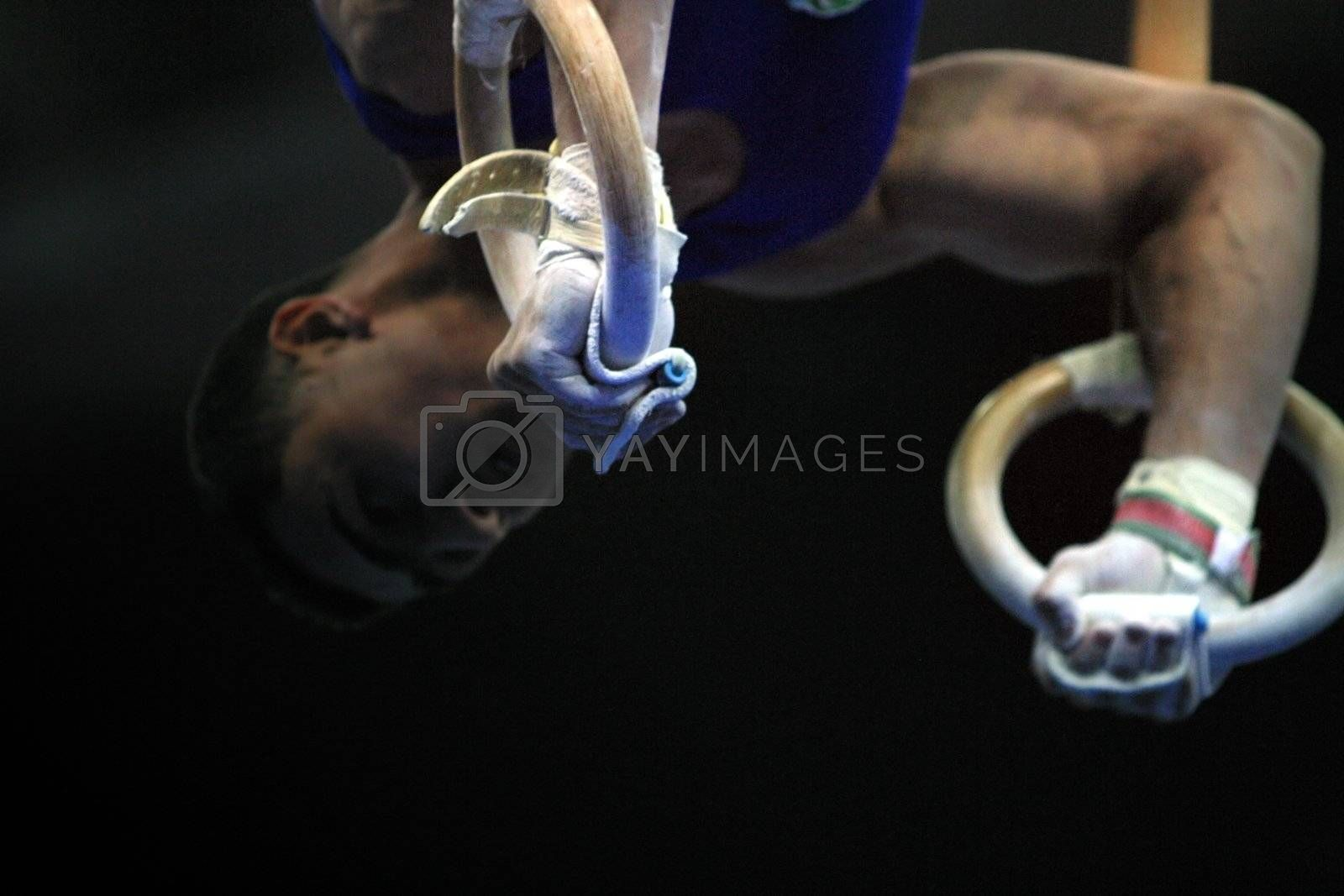 Close up of the gymnast competing on rings