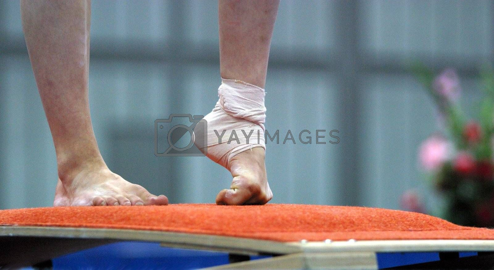 Close-up of legs of the gymnast before a jump
