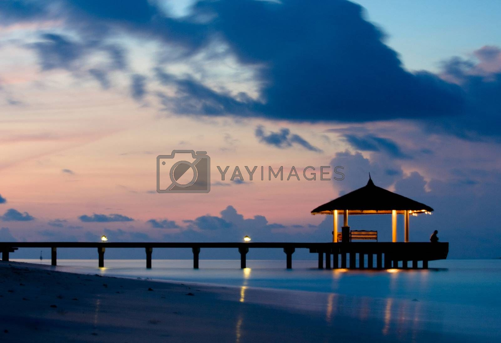 Bridge silhouette and tranquil ocean in the twilight