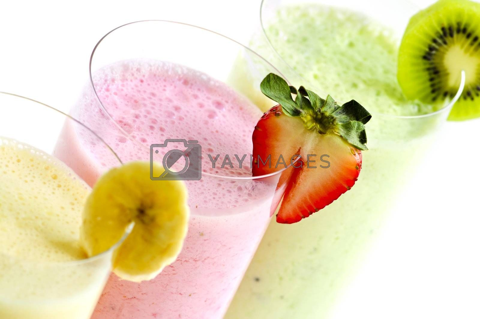 Assorted fruit smoothies close up on white background
