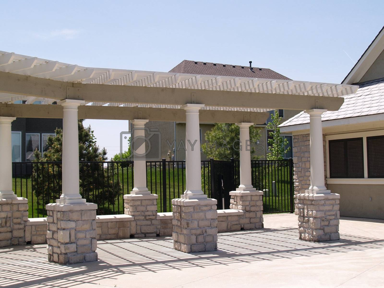 columns and trellised covered walkway