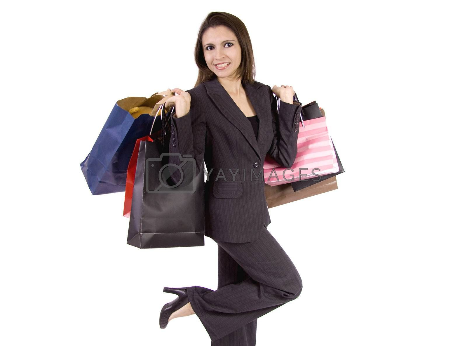 A beautiful woman is celebrating all the things she has bought on a shopping spree