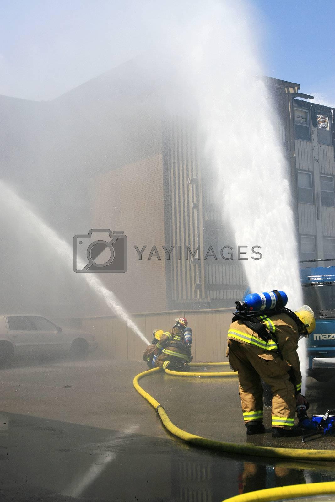 Firefighters battle a three alarm blaze.
