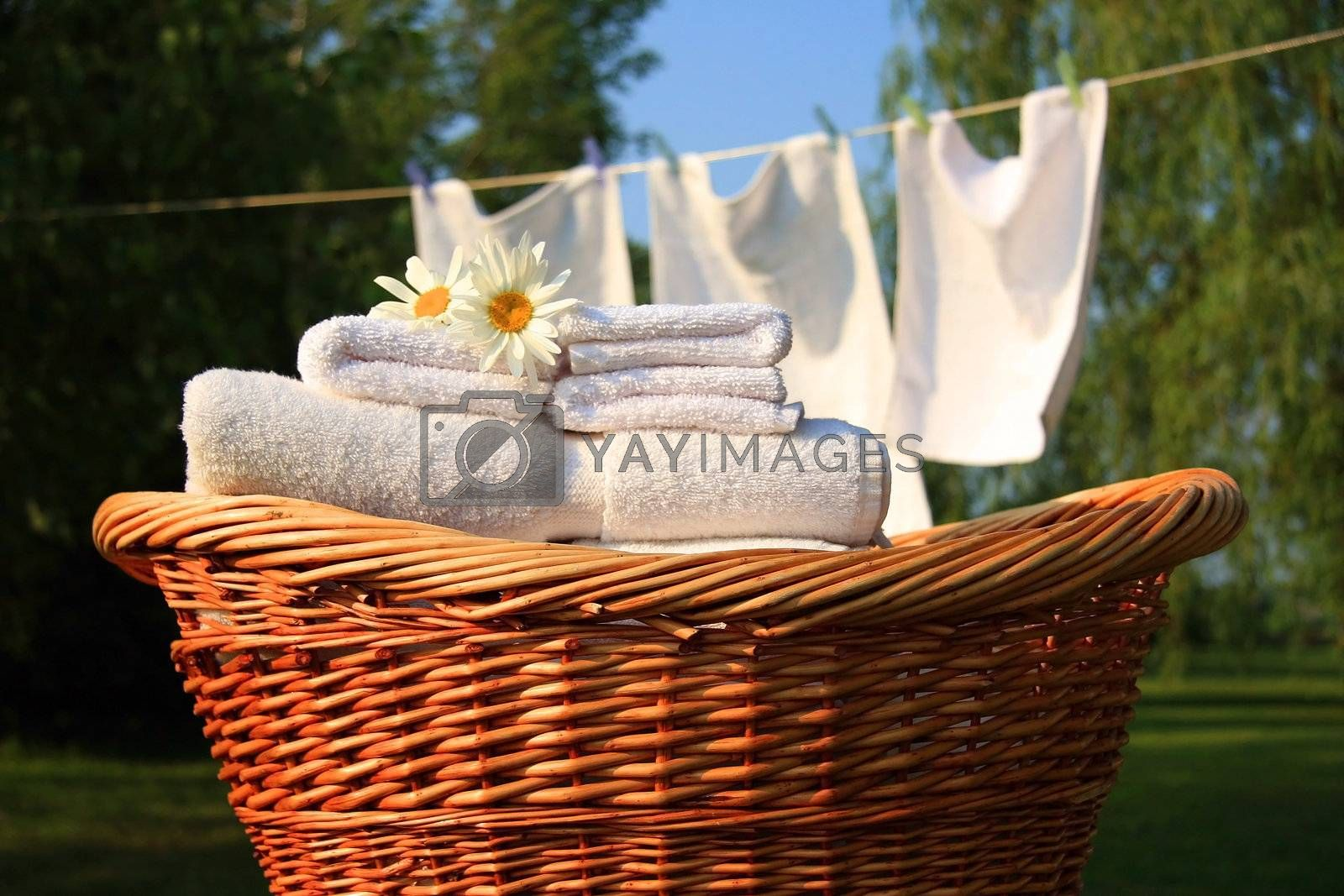 Wicker basket with laundry against a blue sky- late afternoon