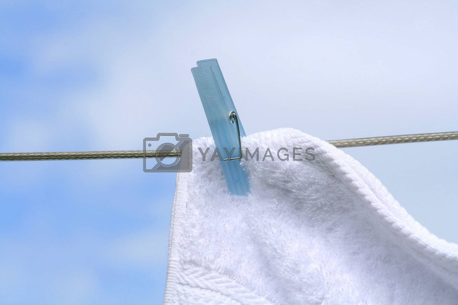 Wash day/Fluffy towel hanging with clothespin on the line