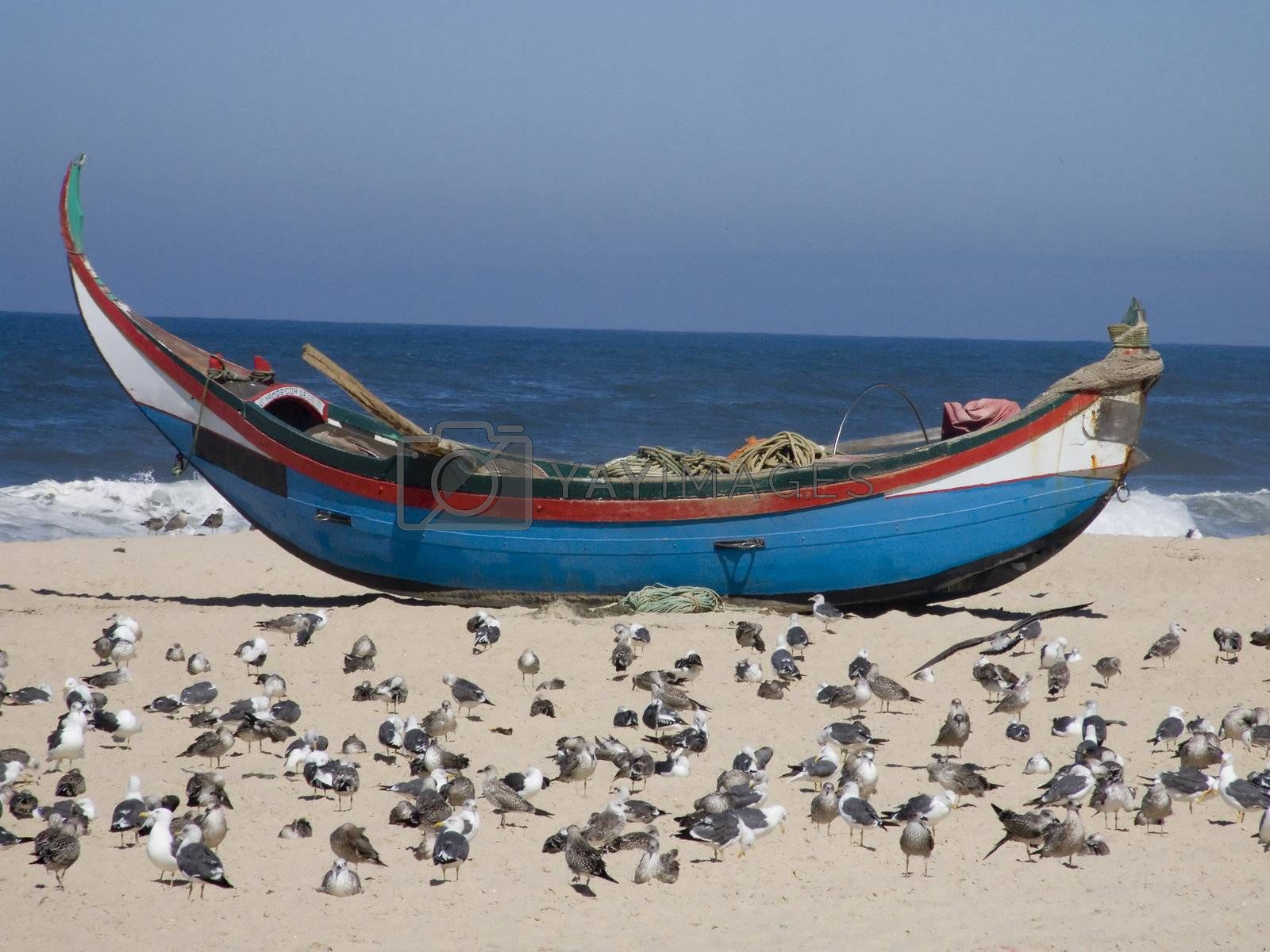 Fisherman boat on the sand by PauloResende