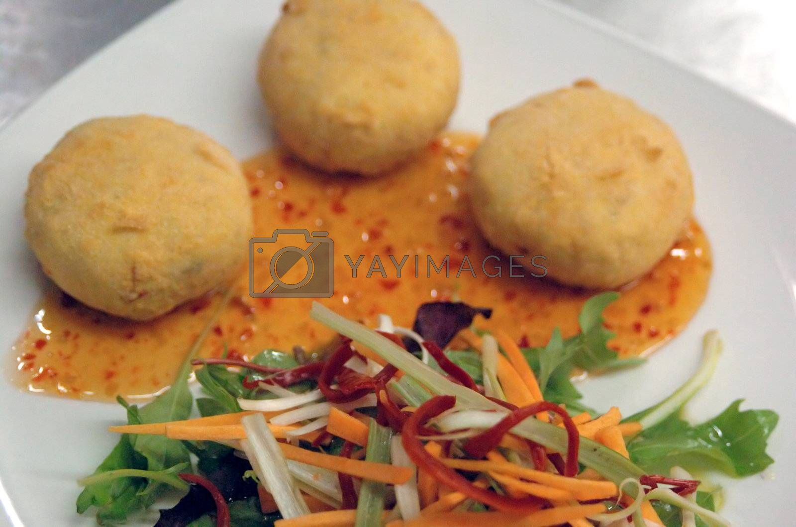 thai style fish cakes with sweet chili drizzle and salad