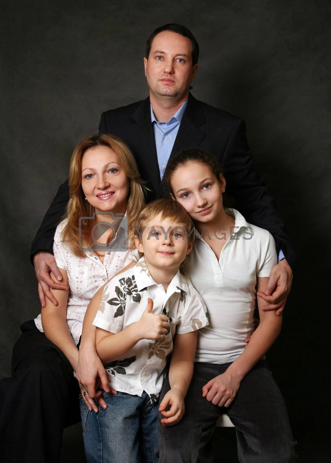 Portrait of parents and children in studio