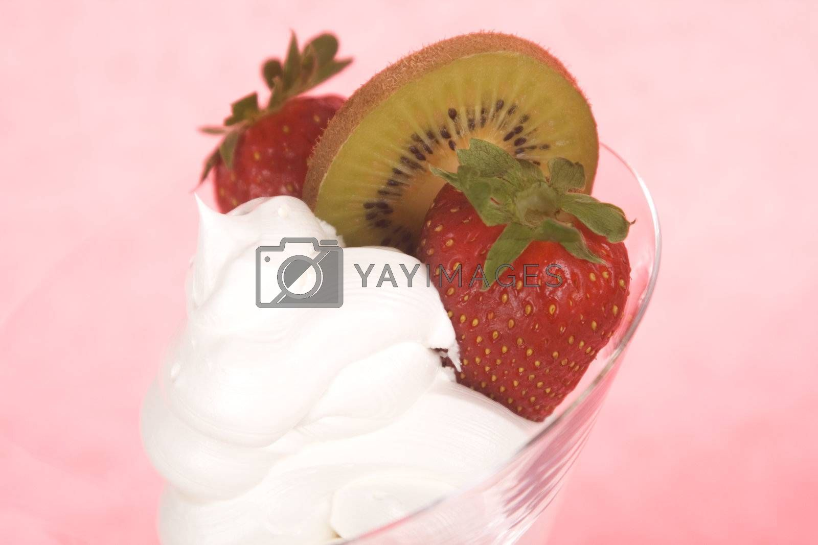 Closeup of cream and strawberries topping