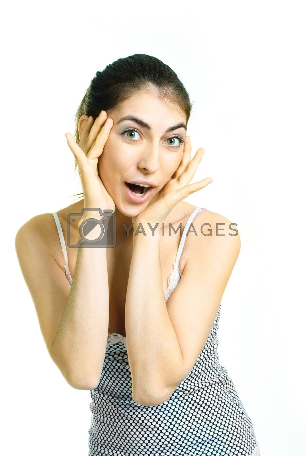 portrait of a beautiful young surprised woman closing her face with hands