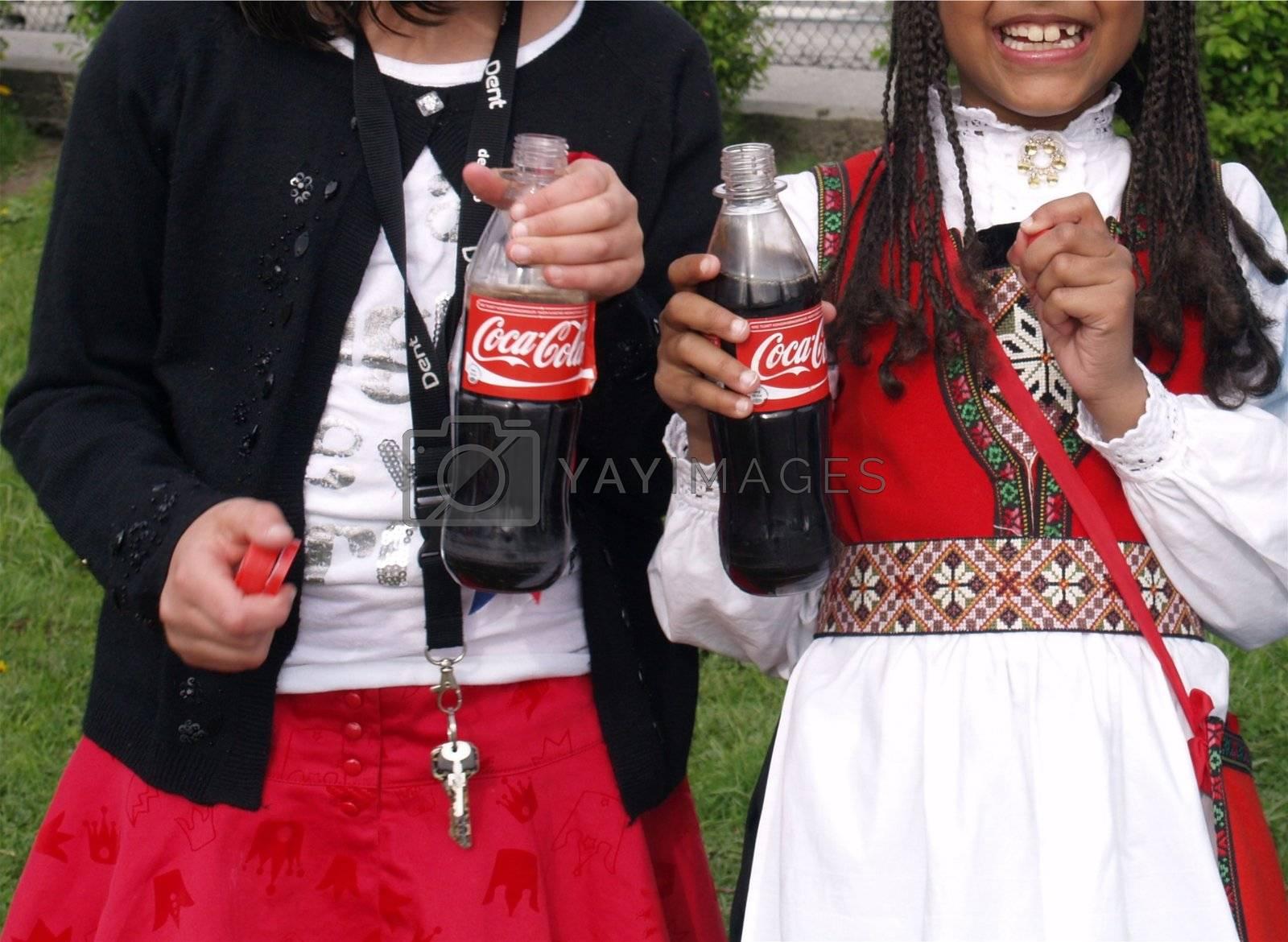 girls enjoying coca cola