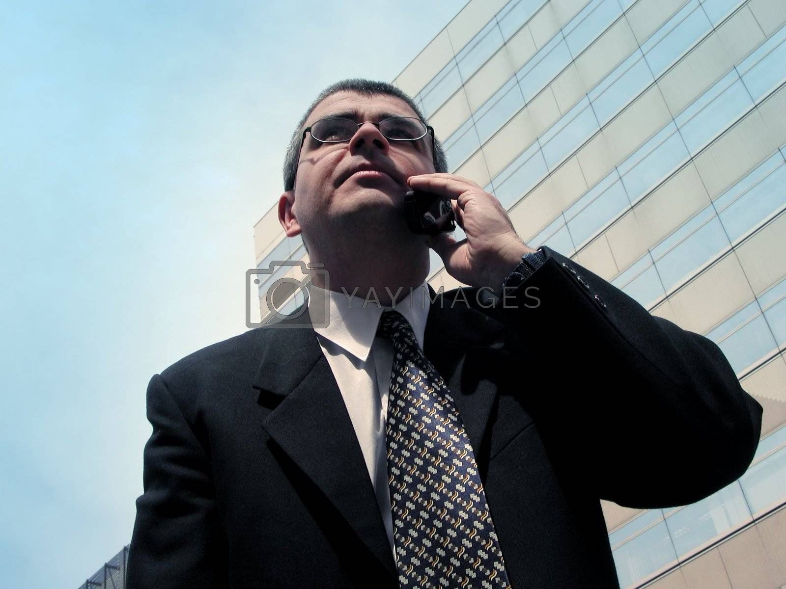 Businessman speaking to the mobile phone in a big city