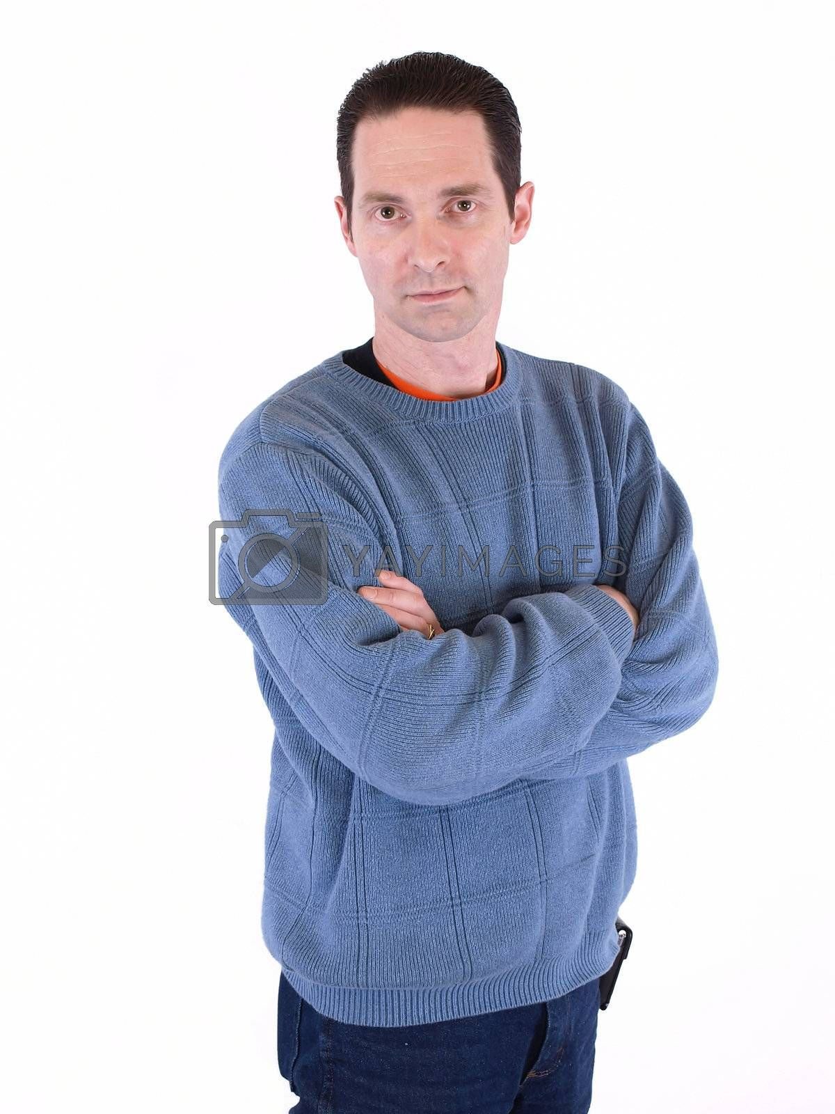 A man in a blue sweater folding his arms, isolated on a white background.