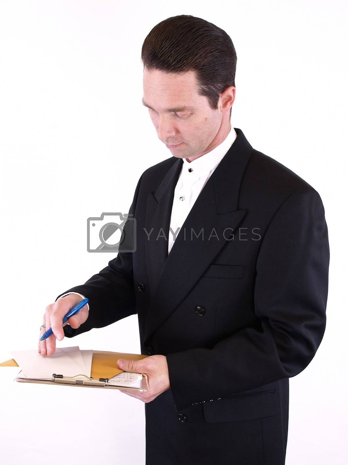 Adult male in a suit holding a clipboard with envelopes and a pen. Isolated on a white background.
