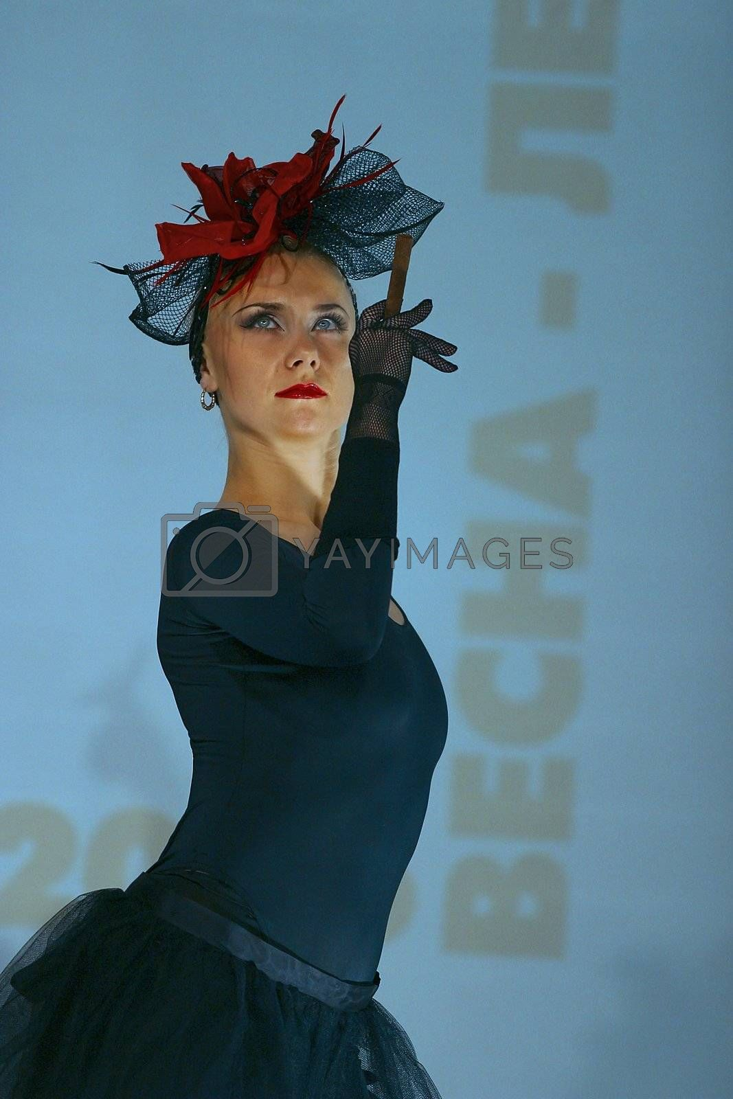 The girl - models in a hat on display of clothes
