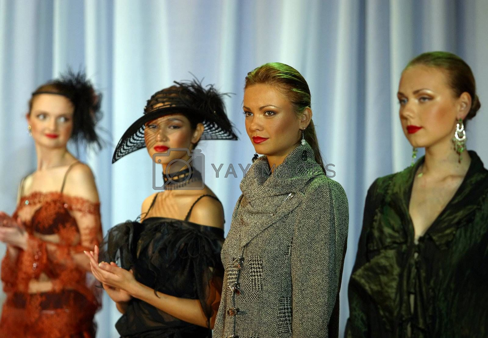 The girls - models in a hat on display of clothes