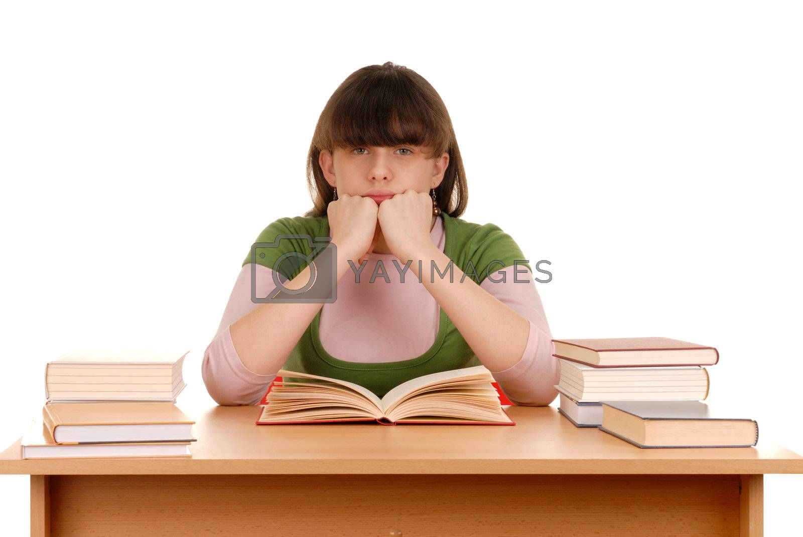 Girl sitting behind a desk with many books on it