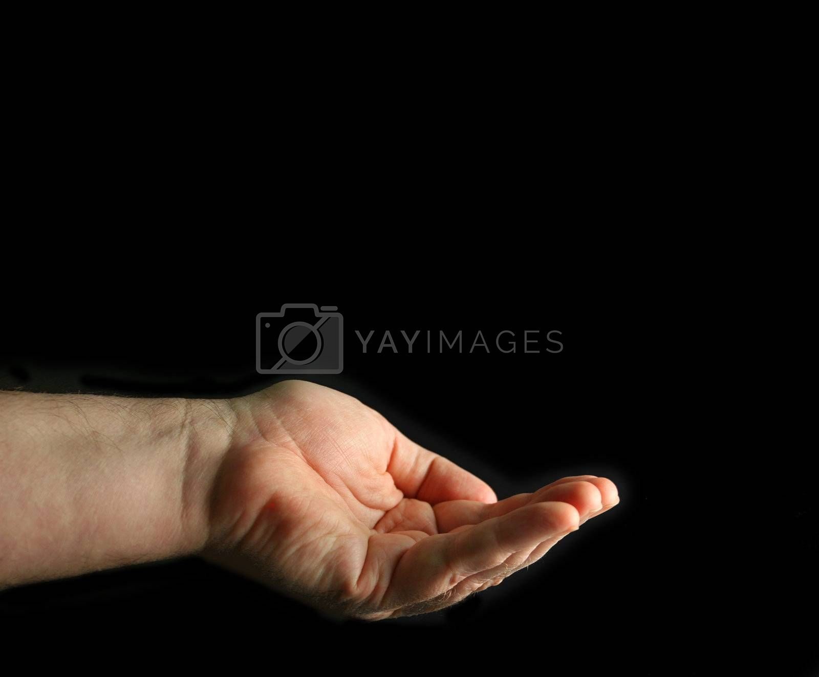 Cupped hand isolated on black.