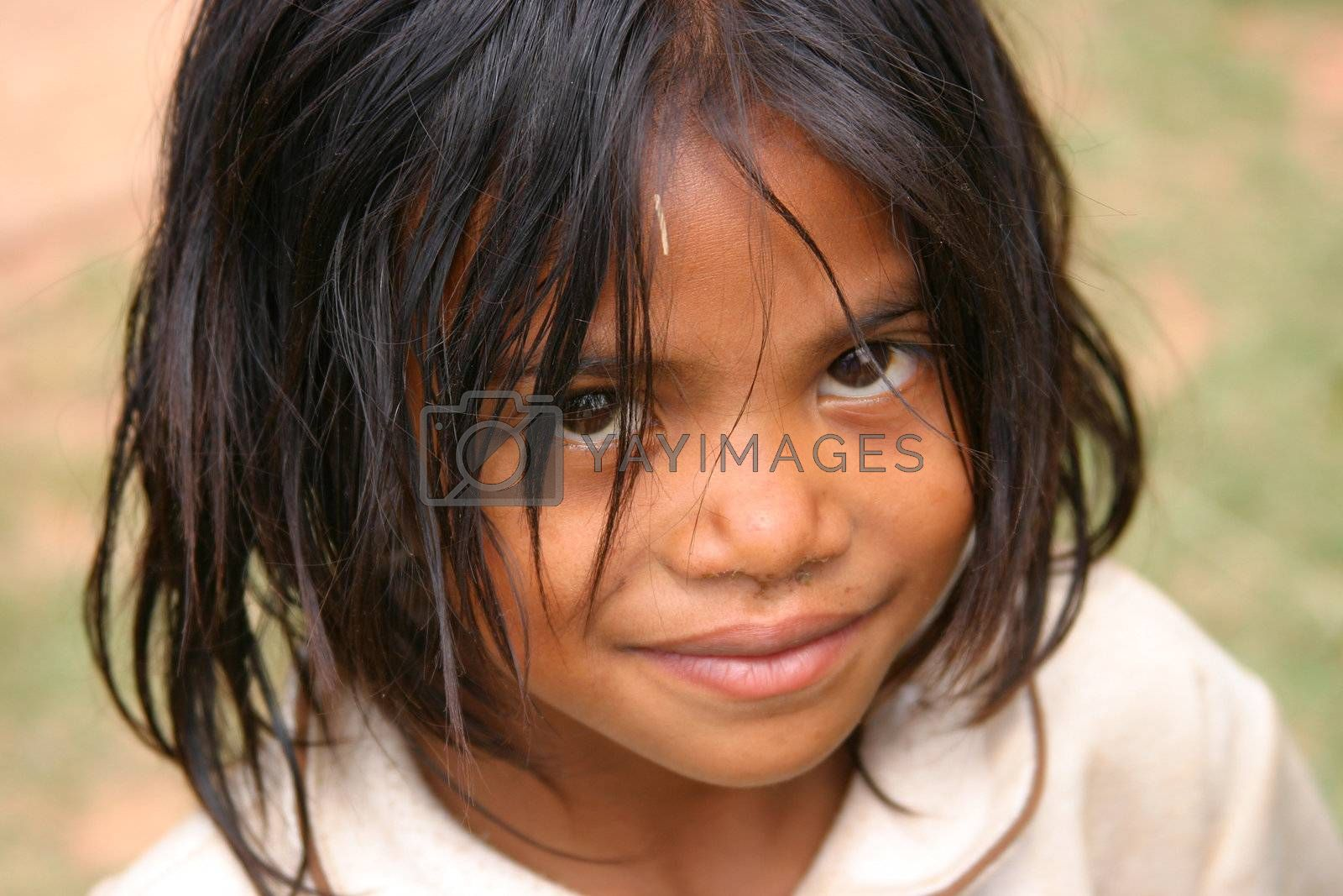Smiling young girl in Madagascar looking up