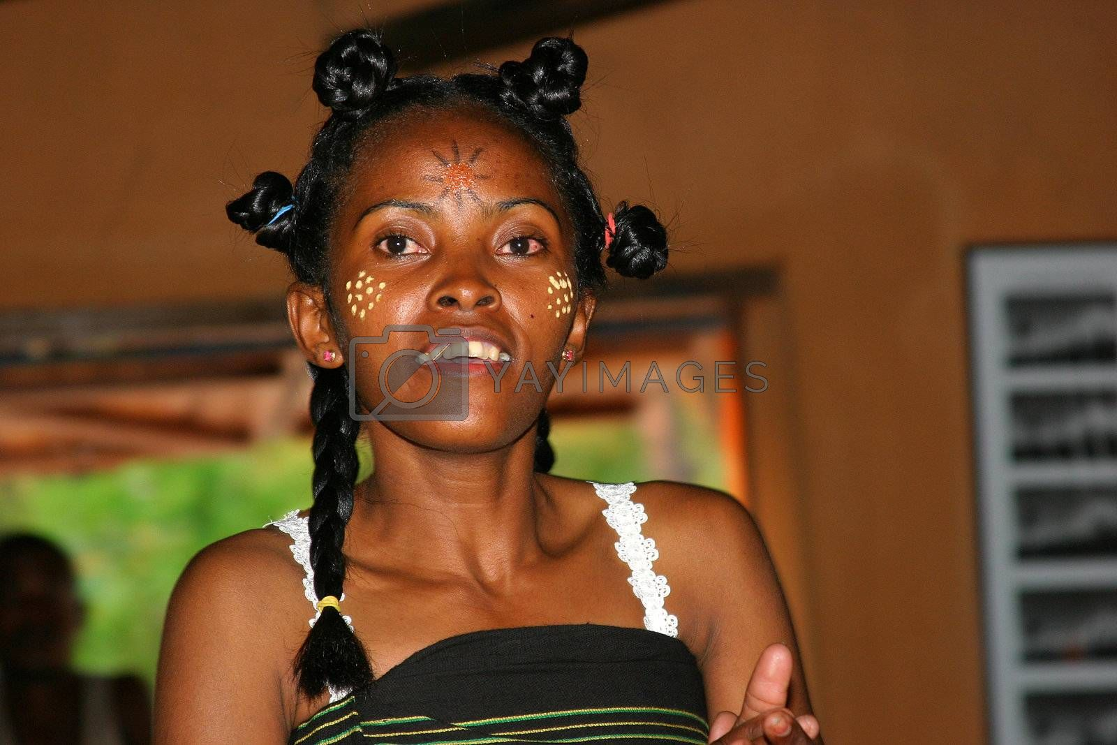 Woman in Madagascar having painted her face to celebrate