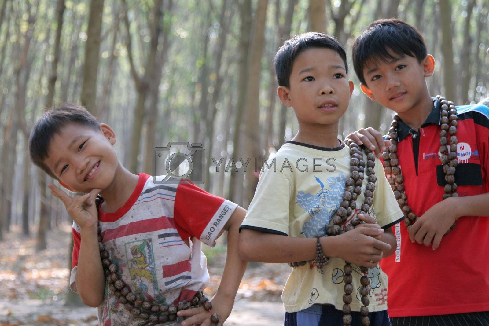 Young children selling tourist junk