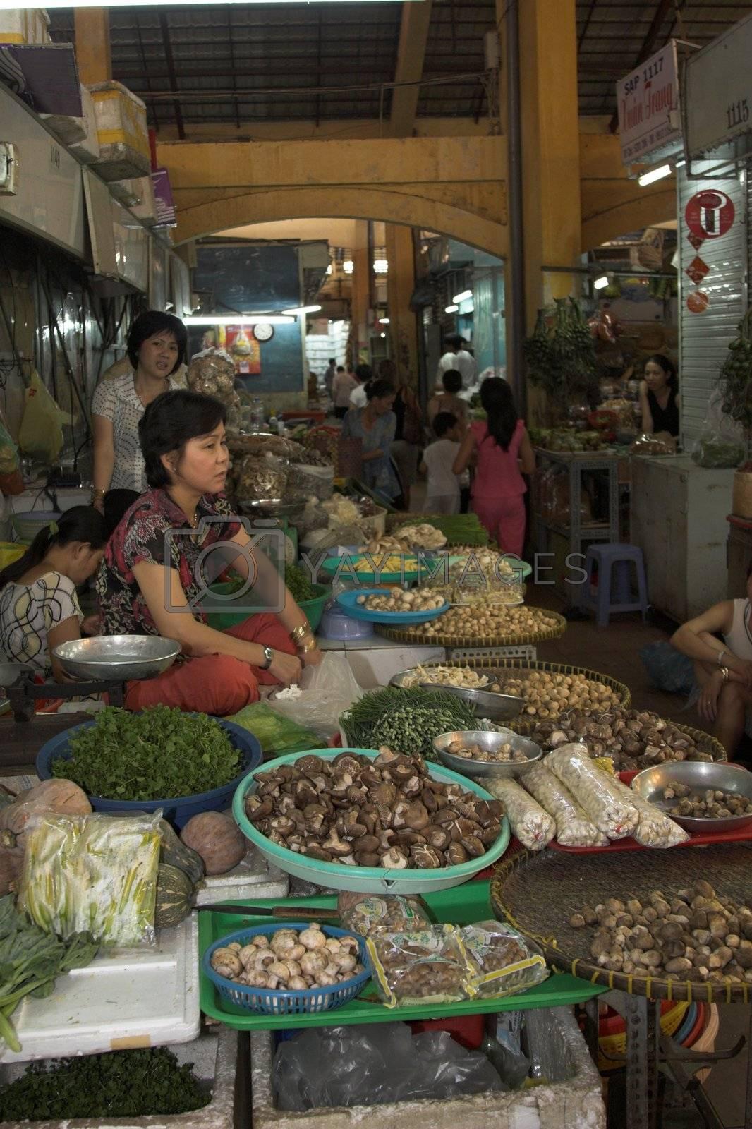 Woman at a market in Saigon