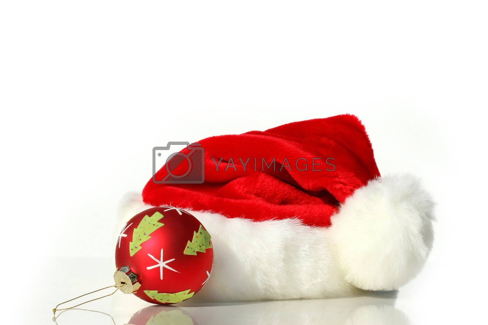 Santa hat with red christmas ball isolated on white background