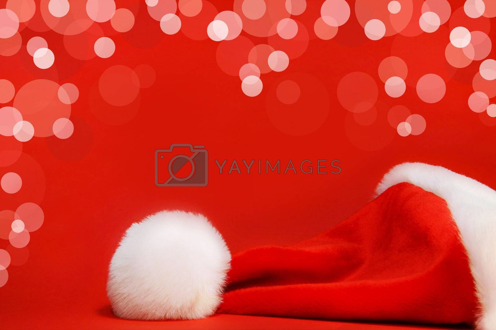 Red santa hat against a red background