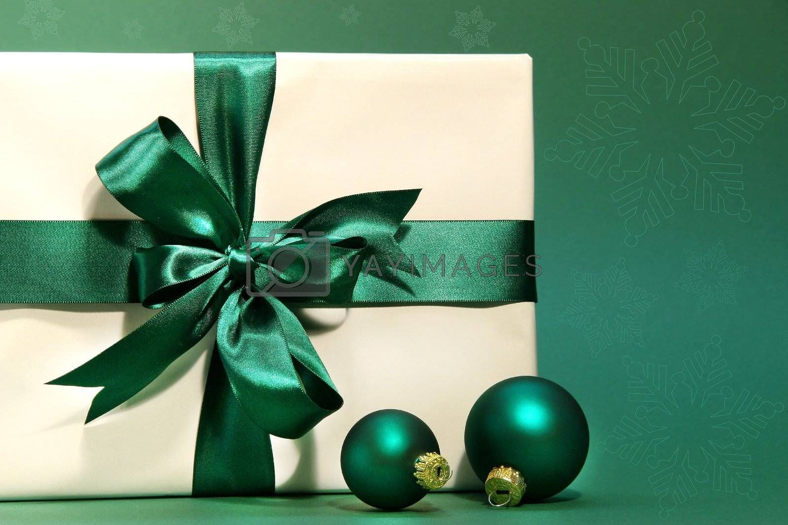 Gift with green bow against a green background