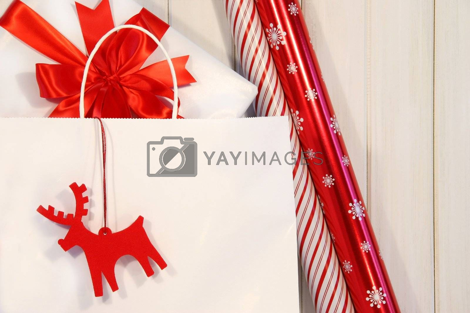 Paper shopping bag filled with gift and wrapping paper