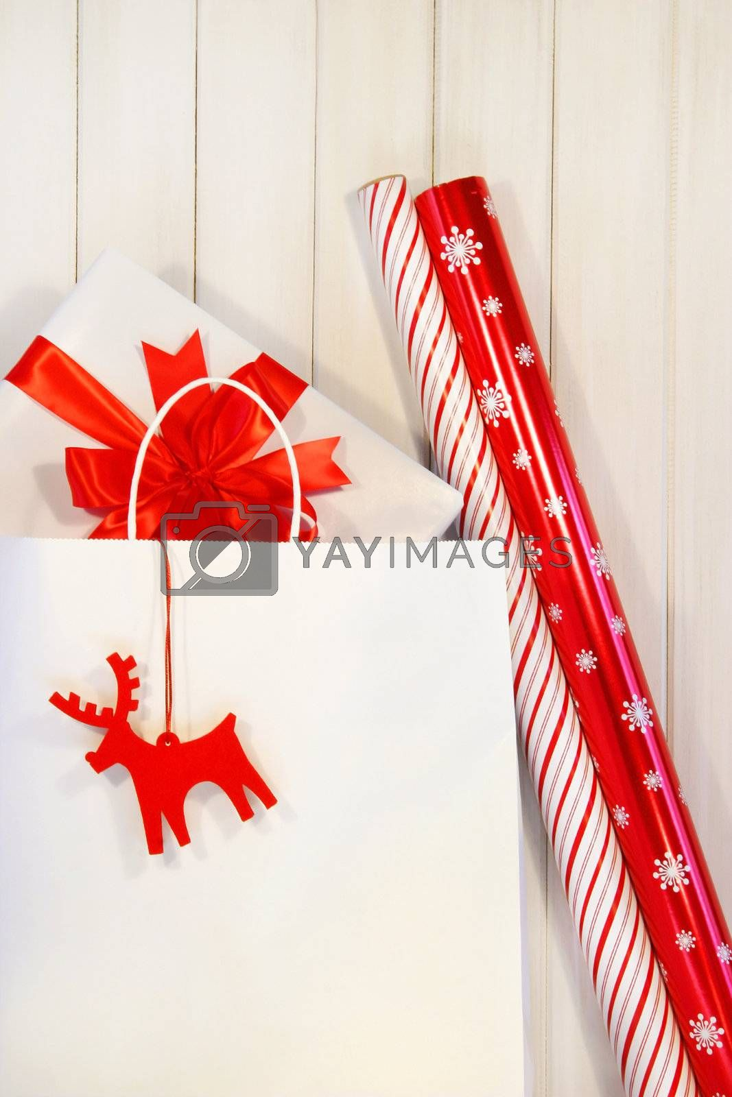 Gift with white shopping bag and wrapping paper
