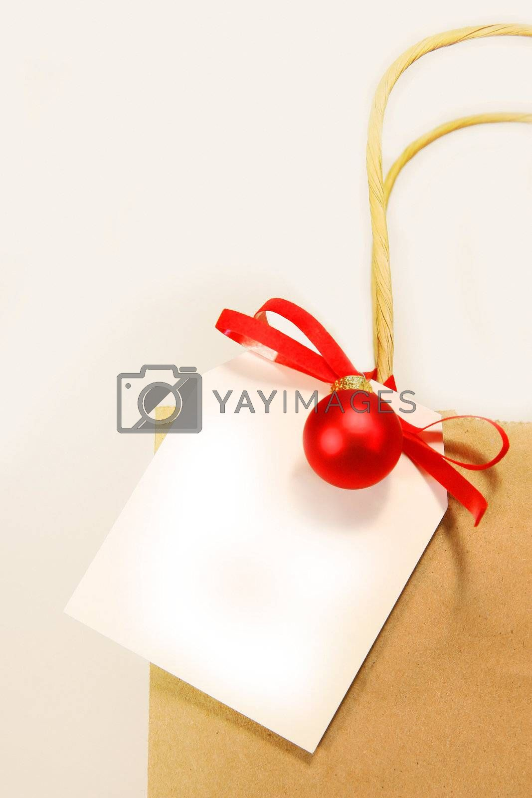 White holiday gift card with shopping bag