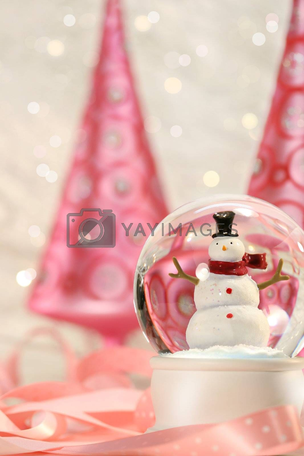 Snow globe with pink christmas trees in a winter white background