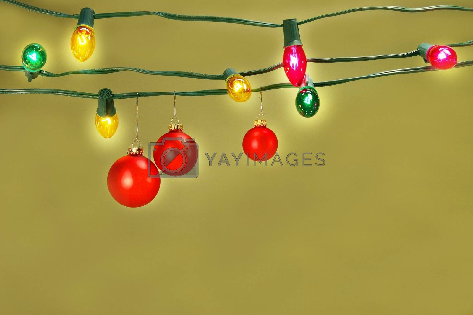 Christmas balls hanging on lights by Sandralise