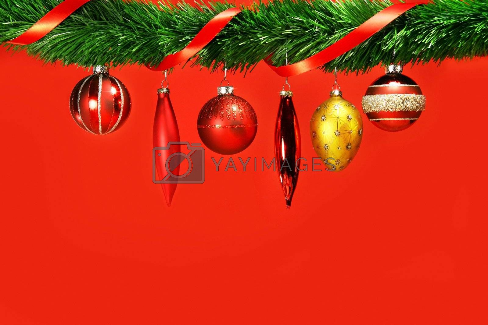 Variety of holidays balls hanging from green garland by Sandralise