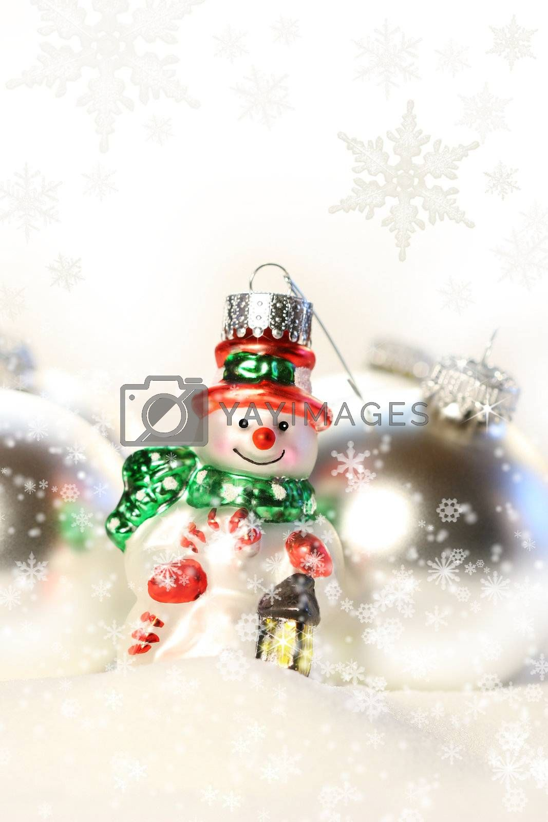Little snowman ornament in the snow by Sandralise