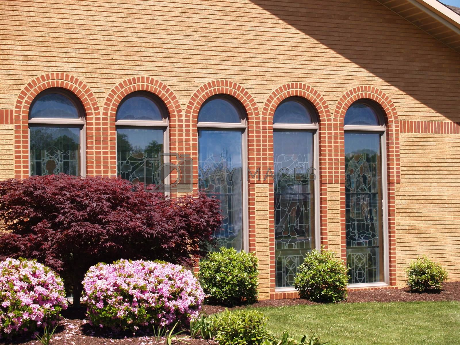 many stained glass arched church windows