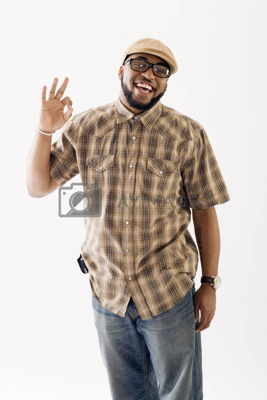 Cool happy African American man giving the A-OK gesture