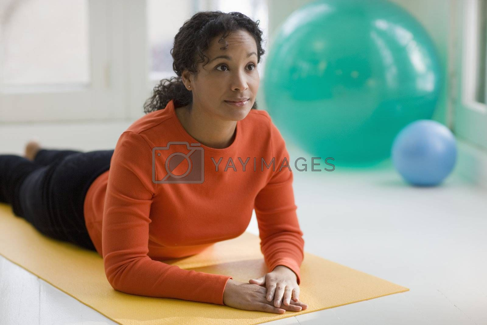 Attractive young African American woman in Sphinx pose