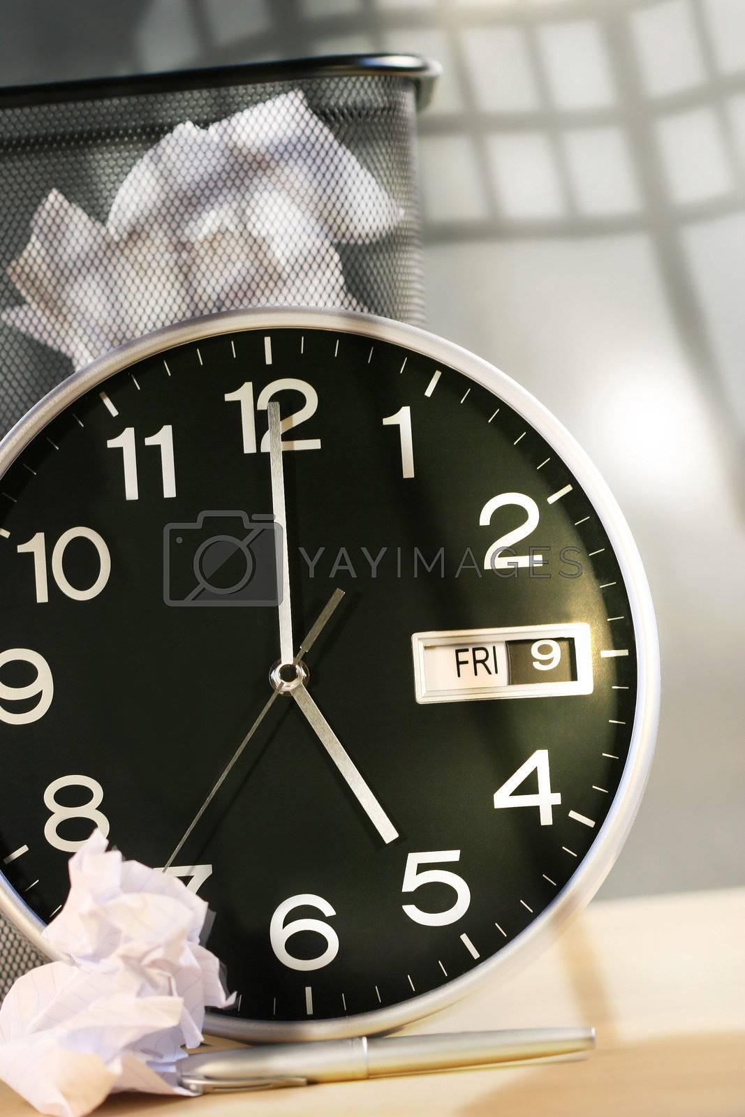 Clock, wast paper basket on desk/ end of work day