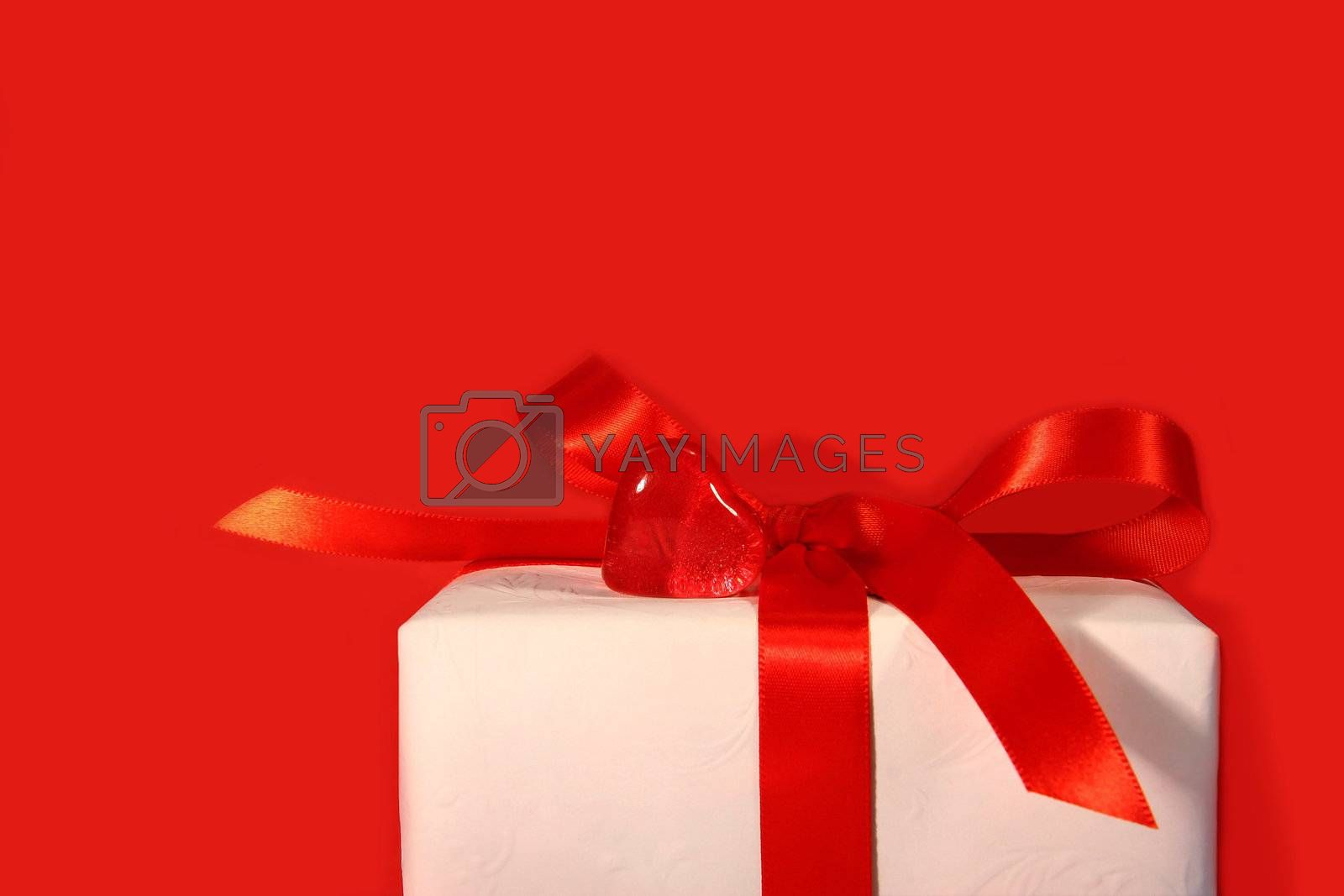 Heart and red bow with red background