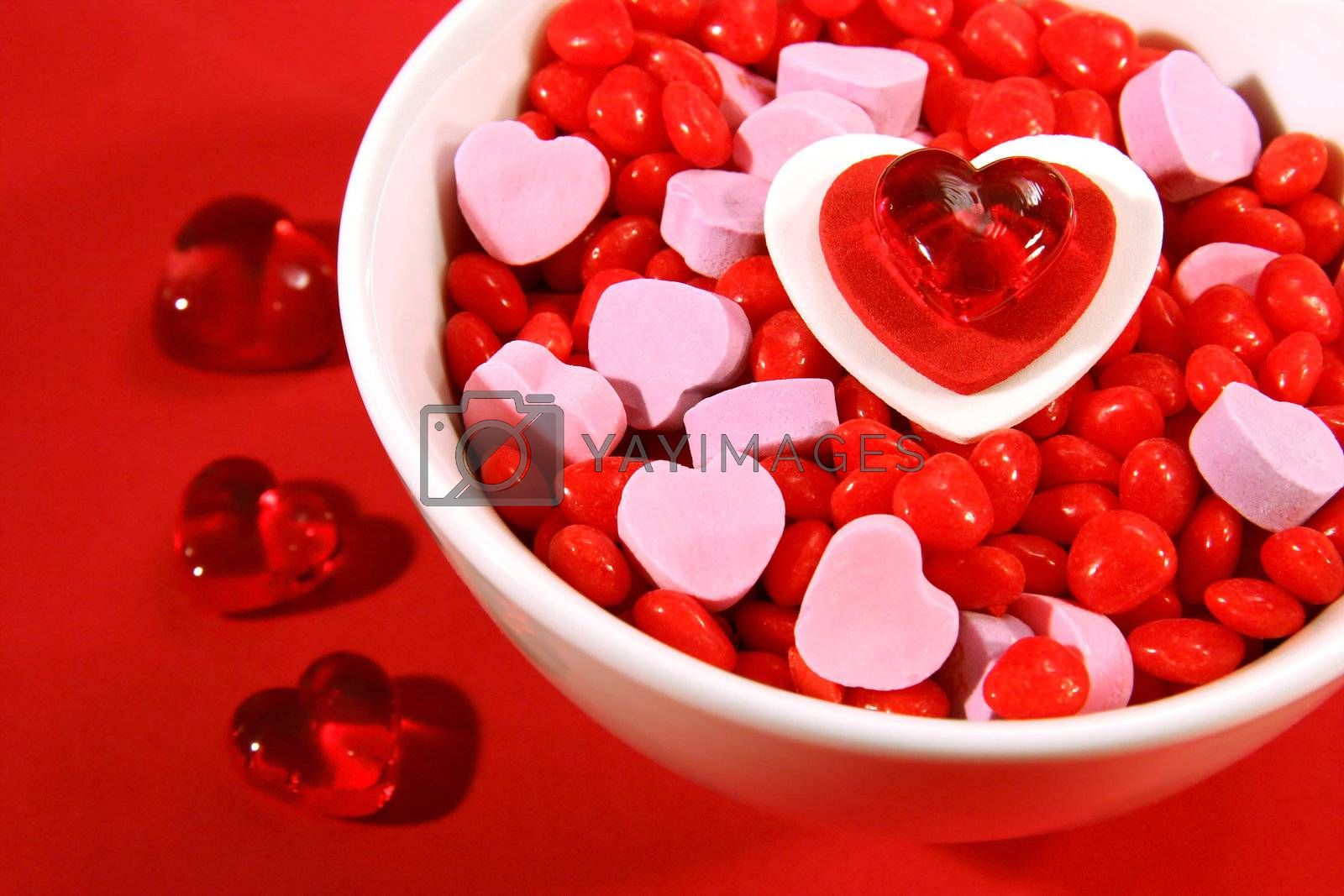 An assortment of Valentine candies in a white bowl