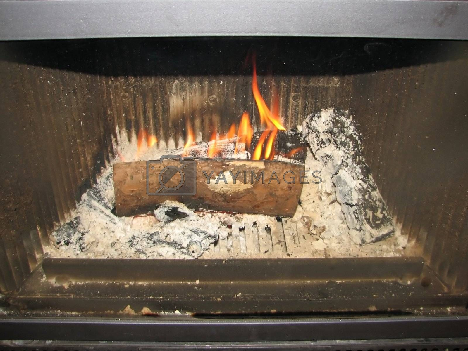 small fire starting to burn in a fireplace
