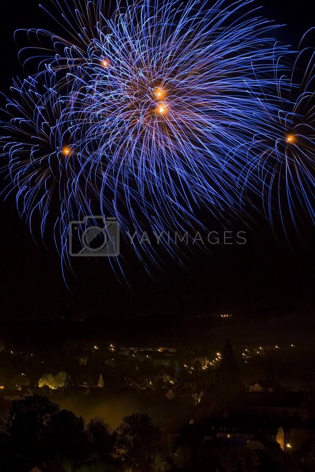 Fireworks by night over a town