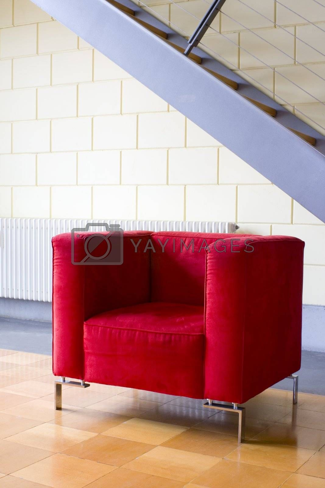 Red armchair and stairs in a modern apartment