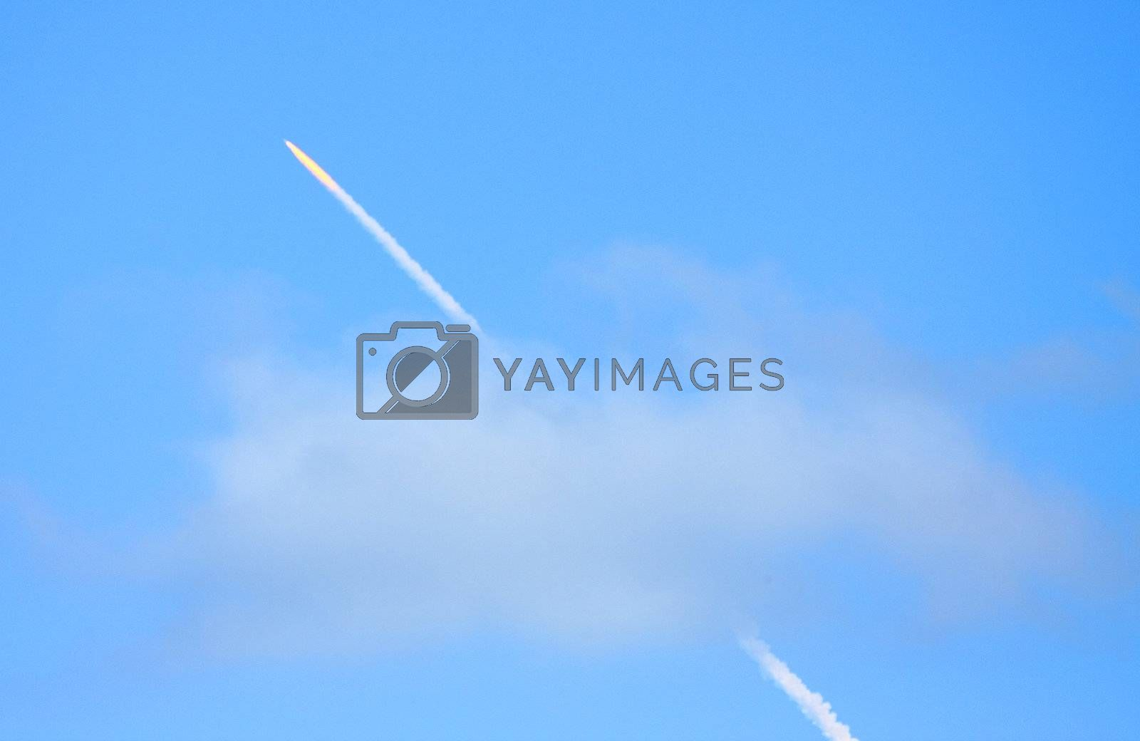 Vapor trail of Space Shuttle Discovery as it launches successfully from Cape Canaveral at 5:02 PM, EST.