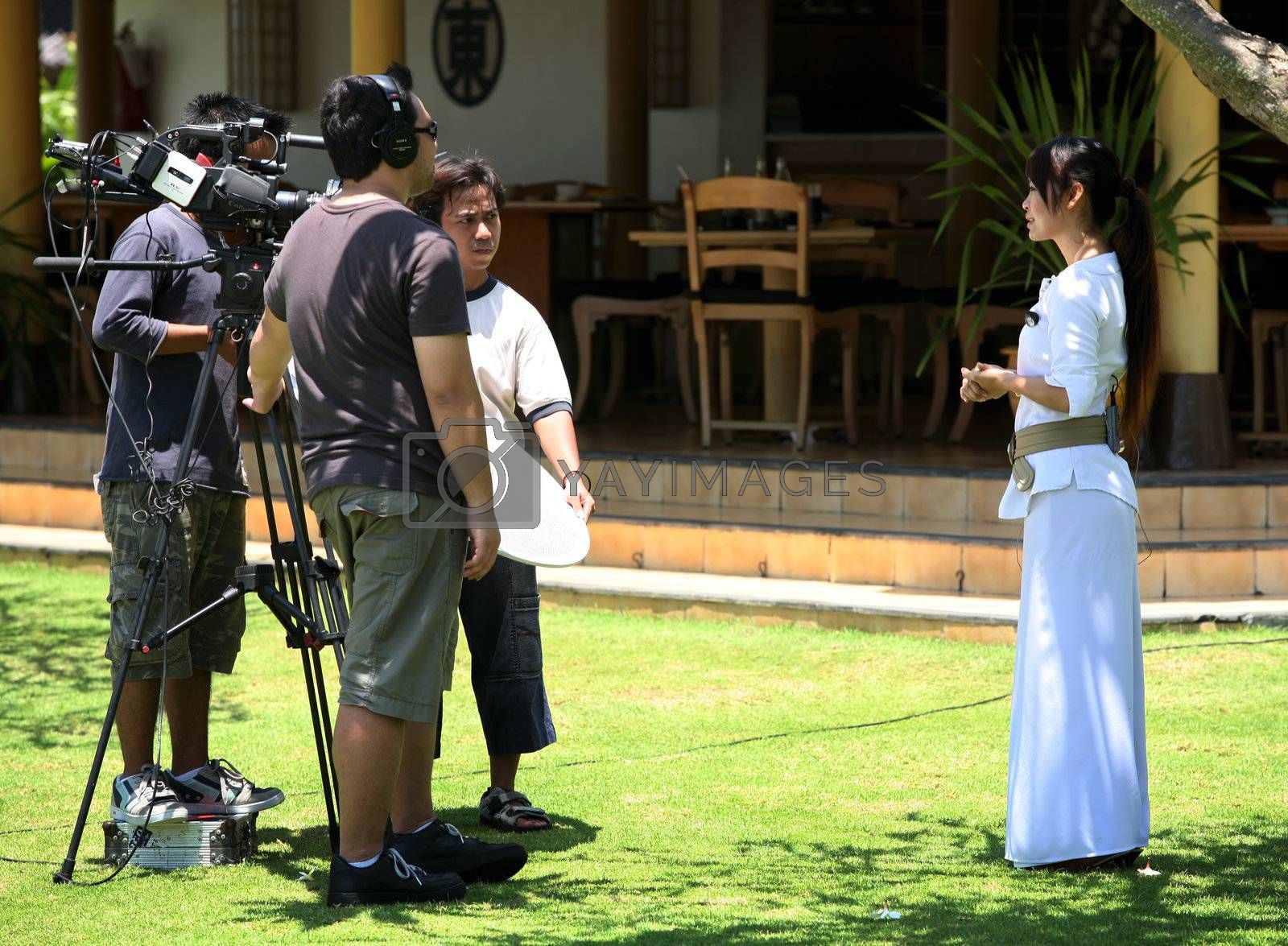 TV reporters presenting the news about Bali